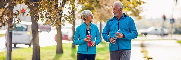 A happy, healthy, older couple out for a walk
