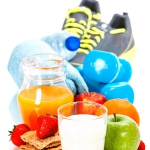 A group of healthy objects including running shoes and fruit